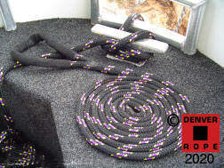 """An example of a custom colored 3/4"""" X 15ft bow dock line with a 12"""" covered eye splice. If your lines are subject to change, then add chafe guard to protect the rope. This custom rope pattern is 4-tracer black background w yellow/purple/ purple/yellow tracers."""