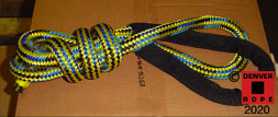 """An example of a custom colored 3/4"""" X 10ft breast dock line with a 12"""" covered eye splice. If your boat is moored in a slip, then cover those eye splices. This custom rope pattern is yellow/black/royal blue 50 / 25 / 25."""